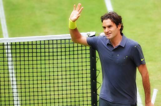 Swiss Roger Federer waves after his seco